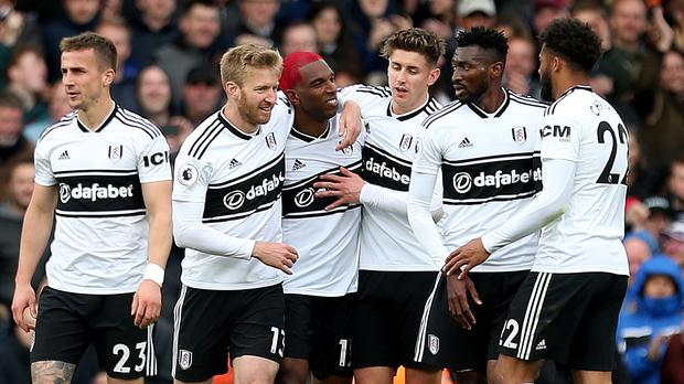 Fulham's Ryan Babel (centre left) celebrates scoring his side's first goal of the game during the Premier League match at Craven Cottage, London.