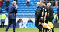 Cardiff manager Neil Warnock (left) silently confronts the officials after the game (Nick Potts/PA)
