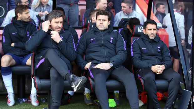 Tottenham Hotspur manager Mauricio Pochettino, centre, kept his counsel after two Spurs players were sent off against Bournemouth (Mark Kerton/PA)
