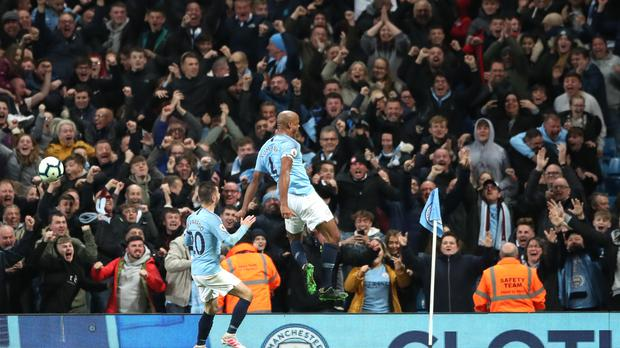 Manchester City's Vincent Kompany celebrates scoring his side's first goal of the game during the Premier League match at the Etihad Stadium, Manchester.