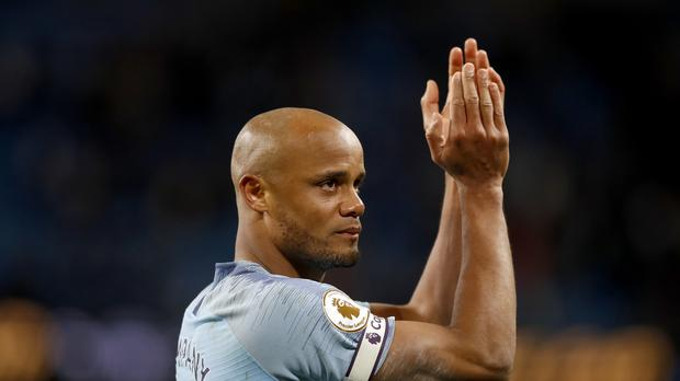 An emotional Vincent Kompany salutes the fans after Manchester City's win over Leicester. (Martin Rickett/PA)
