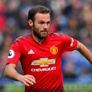 Juan Mata has extended his five-year stay at Manchester United (Anthony Devlin/PA)