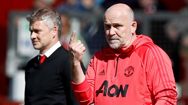 Mike Phelan (right) signed a three-year deal to stay as assistant manager at Old Trafford on Friday (Martin Rickett/PA)