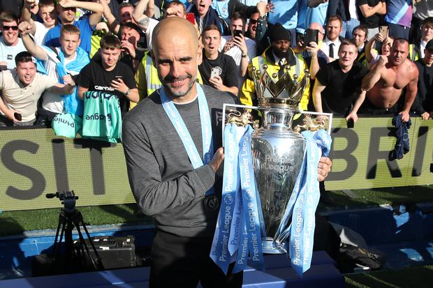 City boss Pep Guardiola has now won back-to-back Premier League and EFL Cup titles, as well as an FA Cup. (Nick Potts/PA)