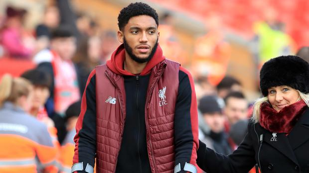 Liverpool's Joe Gomez admits it hurt having to watch from the sidelines while he was injured (Peter Byrne/PA)