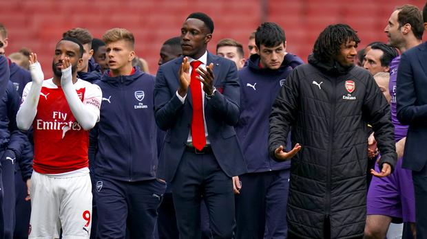 Danny Welbeck (centre) has said his goodbyes to the Arsenal fans (John Walton/PA)