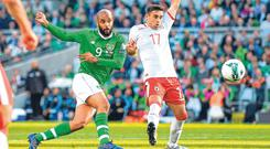 David McGoldrick takes a shot which is deflected into the goal by Joseph Chipolina of Gibraltar during last night's Euro 2020 qualifier. Photo: SEB DALY/SPORTSFILE.