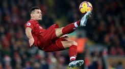 Liverpool defender Dejan Lovren is attracting interest from AC Milan (Peter Byrne/PA)
