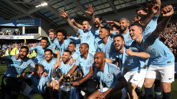 Manchester City celebrate their latest title triumph after winning at Brighton on the last day of the 2018-19 season (Nick Potts/PA)
