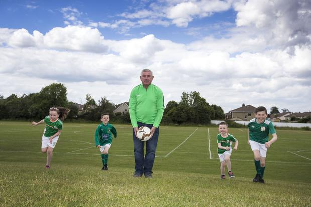 Former Shamrock Rovers player and manager Pat Byrne with his grandchildren Chloe Byrne and Matthew Byrne and their Knocklyon United clubmates Nathan Walshe and James Walshe (6) at Ballycullen Park recently. Photo: Colin O'Riordan