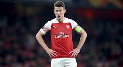 Former Arsenal striker Ian Wright has heavily criticised Laurent Koscielny, pictured, for refusing to go on the pre-season tour of the United States (Adam Davy/PA)