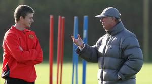 Solskjaer, left. and Ferguson are in regular contact, although not as much as people believe. (Martin Rickett/PA)