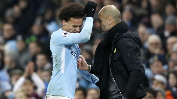 Pep Guardiola, right, believes Leroy Sane has a big part to play in the new season for Manchester City. (Martin Rickett/PA)