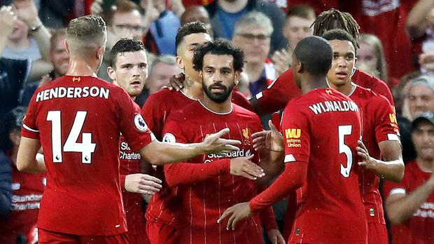 Mohamed Salah celebrates his goal as Liverpool enjoyed a rout of Norwich (Martin Rickett/PA)