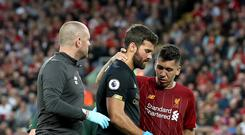 Liverpool must wait to learn the extent of Alisson's injury (Martin Rickett/PA)