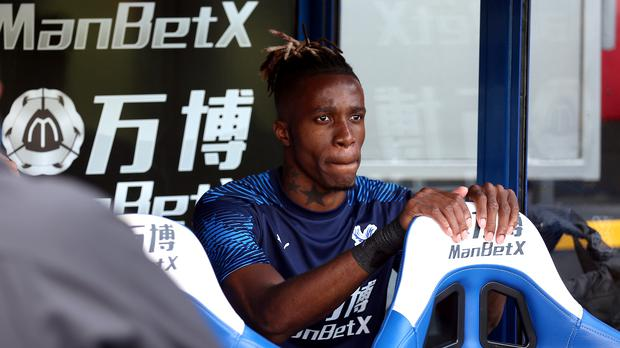 Wilfried Zaha was named on the bench before Crystal Palace's meeting with Everton (Nigel French/PA)