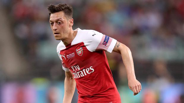 Mesut Ozil is one of two Arsenal players withdrawn this weekend due to security incidents (Adam Davy/PA)