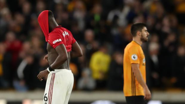 Manchester United's Paul Pogba looks dejected after the Premier League match at Molineux, Wolverhampton.