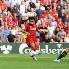 Mohamed Salah, centre, scores Liverpool's third goal (Anthony Devlin/PA)