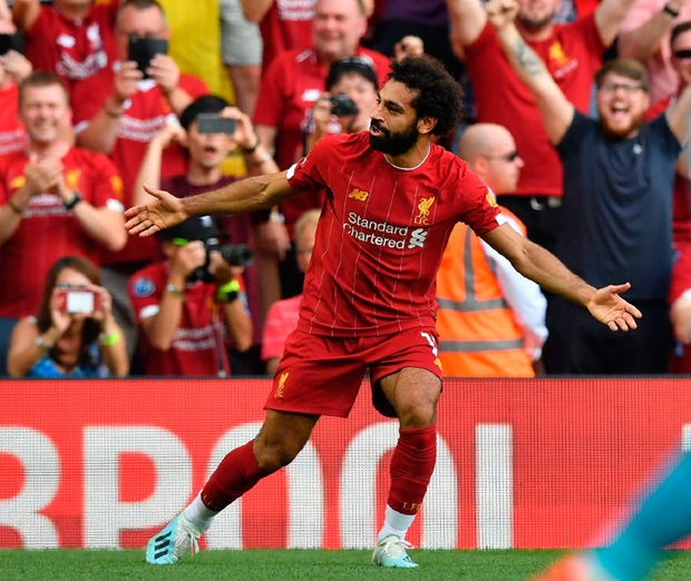 Mohamed Salah celebrates after scoring his second goal at Anfield yesterday. Photo: Ben Stansall/Getty
