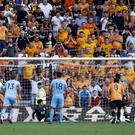 Raul Jimenez slots home his penalty in stoppage time (Darren Staples/PA)