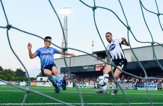 Michael Duffy (right) scores his second goal for Dundalk against UCD last night at Oriel Park. Photo: Seb Daly/Sportsfile