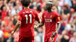 Sadio Mane (right) and Mohamed Salah (left) are pictured during Liverpool's recent win over Newcastle (Nigel French/PA)
