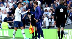 Tottenham manager Mauricio Pochettino will hope his team can make it back-to-back Premier League wins at Leicester (Yui Mok/PA).