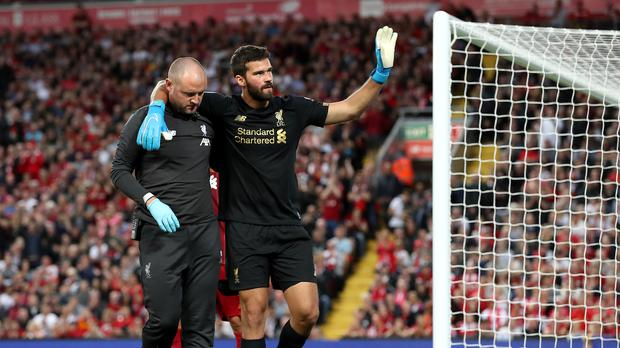 Alisson Becker sustained a calf injury in Liverpool's 4-1 win over Norwich on August 9 (Martin Rickett/PA)..