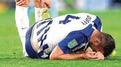Brighton's Shane Duffy falls to the ground with an injury that forced him off during last night's EFL Cup clash. Photo: PA