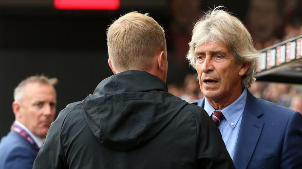 Howe and Pellegrini were involved in a heated exchange of views (Mark Kerton/PA)