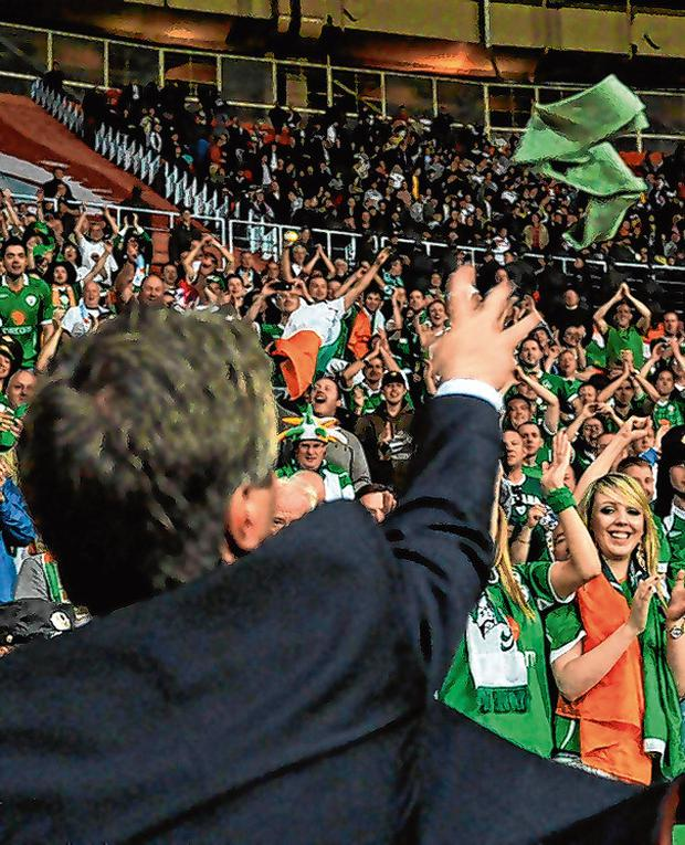 John Delaney throws his tie into the crowd in Moscow after Ireland's draw with Russia in 2011. Photo: David Maher / Sportsfile