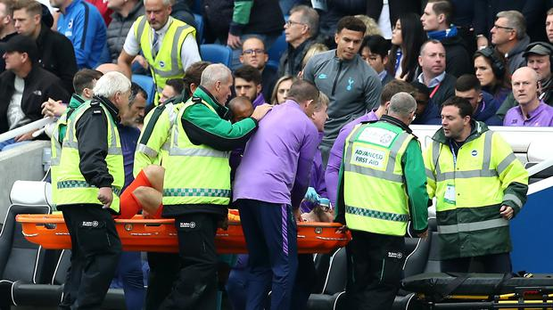 Lloris was stretchered off the pitch (Gareth Fuller/PA)