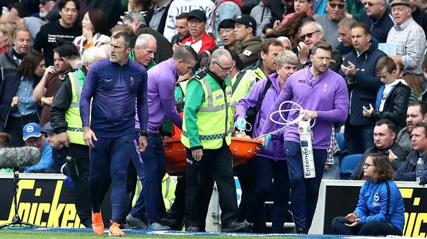Tottenham goalkeeper Hugo Lloris is carried off the pitch (Gareth Fuller/PA)