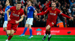 James Milner celebrates with team-mate Jordan Henderson after scoring Liverpool's late winner from the spot yesterday. Photo: Clive Brunskill