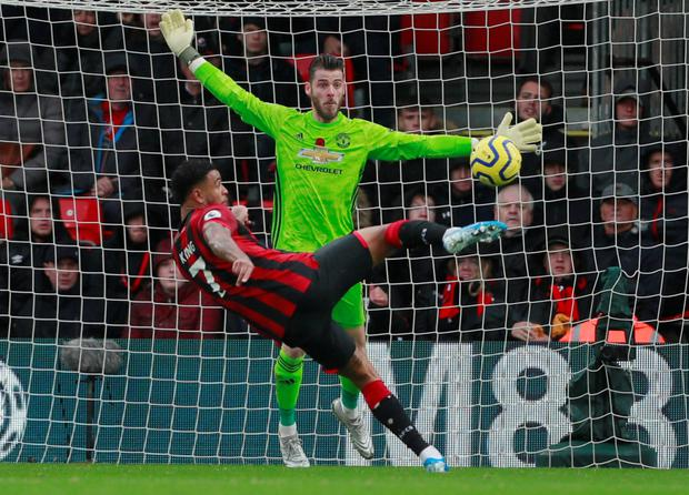 Joshua King lines up his match-winning shot against Manchester United goalkeeper David de Gea at the Vitality Stadium. Photo: Andrew Couldridge/Reuters