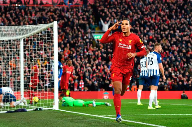 Liverpool's Virgil van Dijk celebrates after scoring his first goal against Brighton and Hove Albion at Anfield yesterday. Photo: PA
