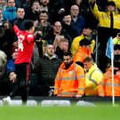 Jesse Lingard and Fred in front of the Manchester City fans (Martin Rickett/PA).