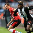 Newcastle's Allan Saint-Maximin (right) faces a month on the sidelines (Owen Humphreys/PA)