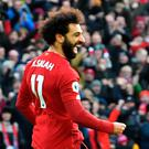 Mo Salah celebrates after netting Liverpoool's opener in their Premier League win over Watford yesterday