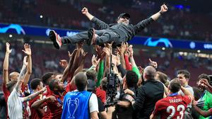 Liverpool manager Jurgen Klopp is hoisted by his squad after Liverpool's Champions League triumph last May (Peter Byrne/PA)