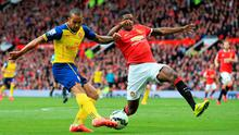 Tyler Blackett deflects Theo Walcott's shot into his own net for Arsenal's equaliser