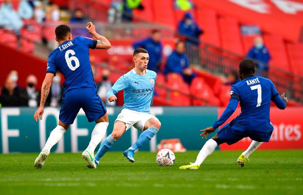 Manchester City's Phil Foden (centre) in action against Chelsea's Thiago Silva (left) and N'Golo Kante during the recent FA Cup semi-final match at Wembley Stadium. Photo: Ben Stansall/PA