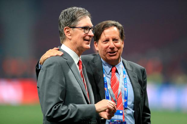 Liverpool owner John W. Henry (left) and chairman Tom Werner could face sanctions. Photo: Mike Egerton/PA Wire.