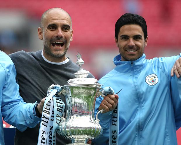 Mikel Arteta, right, celebrates winning the 2019 FA Cup with Pep Guardiola last May (Nick Potts/PA)