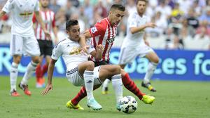 Swansea City's Neil Taylor and Southampton's Dusan Tadic during the Barclays Premier League match at the Liberty Stadium, Swansea.