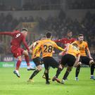 Liverpool's Roberto Firmino scored a late winner at Wolves (Nick Potts/PA)