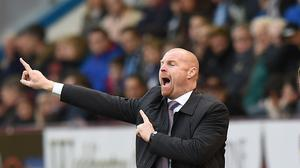 Burnley manager Sean Dyche has urged striker Danny Ings to keep smiling
