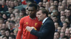 Liverpool manager Brendan Rodgers, right, is not ruling Daniel Sturridge, left, out of the Merseyside derby