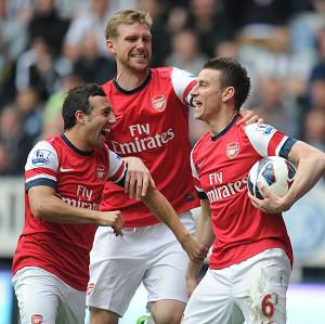 Laurent Koscielny, right, was on target minutes after the break as Arsenal claimed the final Champions League spot